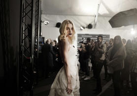 Jessica Stam is seen backstage ahead of the Ermanno Scervino show