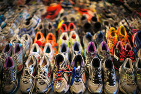 Running shoes left at the makeshift memorial following the 2013 Boston Marathon bombings are displayed in an exhibit at the Boston Public Library in Boston, Massachusetts in this April 16, 2014 photo.