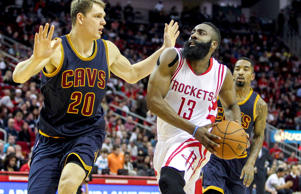 Mar 1, 2015; Houston, TX, USA; Houston Rockets guard James Harden drives the ball to the basket as Cleveland Cavaliers center Timofey Mozgov defends at Toyota Center.