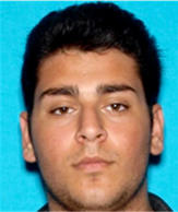 This undated California Department of Motor Vehicles file photo, released by the Los Angeles Police Department, shows Henry Gevorgyan. Gevorgyan, 21, suspected of driving a car in an illegal Los Angeles street race crash that killed two spectators, turned himself in Saturday evening, Feb. 28, 2015. He has been booked on suspicion of murder and is being held on $2 million bail, jail records show.