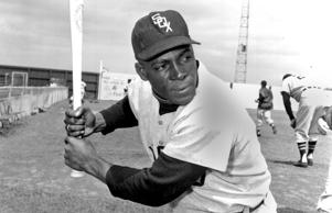 "Chicago White Sox outfielder Orestes ""Minnie"" Minoso poses in batting position at Al Lopez Field in Tampa, Fla., on March 9, 1957."