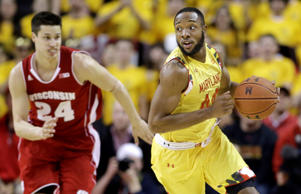 Maryland guard/forward Dez Wells, right, drives past Wisconsin guard Bronson Koenig in the second half of an NCAA college basketball game, Tuesday, Feb. 24, 2015, in College Park, Md.
