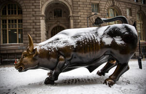 The Wall Street Bull, officially called Charging Bull, is covered in snow the morning after a snowstorm on January 27, 2015 in New York City. The storm, which was predicted to dump 20-30 inches of snow causing roads, highways and the subway to be shut down, was weaker than expected in New York City but hit Eastern Long Island and the New England region with full force.