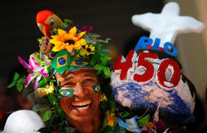 A reveler attends celebrations to mark the 450th anniversary of the city of Rio de Janeiro March 1, 2015.