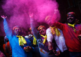 File: Hindu devotees daubed in colour throw coloured powder inside the Bankey Bihari temple during Holi celebrations in Vrindavan, in the northern Indian state of Uttar Pradesh March 1, 2015. Holi, also known as the Festival of Colours, heralds the beginning of spring and is celebrated all over India.