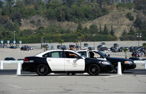 Los Angeles Police Department officers patrol in a squad car on April 10, 2012 in Los Angeles, California.