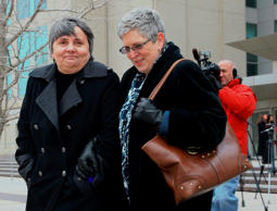 Susan Waters, left, and Sally Waters walk away from Federal Court in Omaha, Neb., after a hearing Thursday, Feb. 19, 2015. Terminally ill Sally and her partner Susan are one of seven same-sex couples who had sued to block Nebraska's ban on gay marriage.