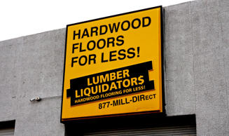 The sign outside the Lumber Liquidators store in Denver February 25, 2015. Rick Wilking/Reuters