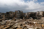 Damaged buildings are seen at al-Ezaa frontline in Aleppo, March 2, 2015.