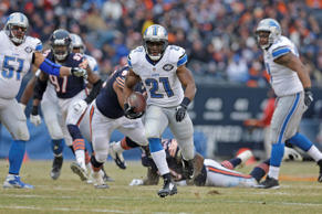 Detroit Lions running back Reggie Bush (21) runs against Chicago Bears defenders in the first half of an NFL football game Sunday, Dec. 21, 2014, in Chicago.