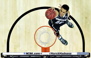 Michigan State Spartans guard Travis Trice dunks against the Virginia Cavaliers in the third round of the 2015 NCAA Tournament on Sunday. Michigan State won 60-54.