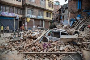 A taxi is buried under debris from a collapsed building in Thamel following an earthquake on April 25, 2015 in Kathmandu, Nepal. A major 7.8 earthquake hit Kathmandu mid-day on Saturday, and was followed by multiple aftershocks that triggered avalanches on Mt. Everest that buried mountain climbers in their base camps. Many houses, buildings and temples in the capital were destroyed during the earthquake, leaving hundreds dead or trapped under the debris as emergency rescue workers attempt to clear debris and find survivors.