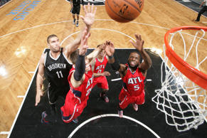 DeMarre Carroll (5) of the Atlanta Hawks grabs a rebound against the Brooklyn Nets in Game 3of the Eastern Conference quarterfinals during the NBA playoffs on April 25, 2015, at the Barclays Center in New York.