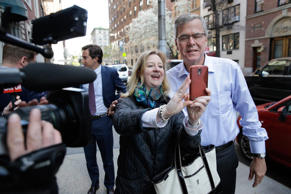 Former Florida Governor Jeb Bush, right, takes a picture with a pedestrian as he arrives to an event in New York City on April 23, 2015.