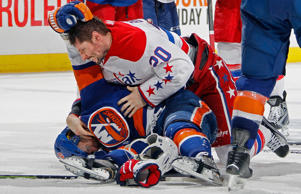 Troy Brouwer of the Washington Capitals and Frans Nielsen of the New York Islanders get involved in an altercation as time runs out in game six of their playoff series April 25 in Uniondale, N.Y. The Islanders won 3-1 to force a game seven.