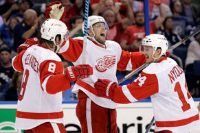 Detroit Red Wings center Riley Sheahan, center, celebrates his goal against the Tampa Bay Lightning during game five of their playoff series April 25 in Tampa, Fla.