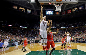 Milwaukee Bucks' Jerryd Bayless puts up the game-winning shot against the Chicago Bulls' Derrick Rose during the second half of Game 4 of a first-round playoff series on April 25, 2015, in Milwaukee, Wisc. The Bucks won 92-90.