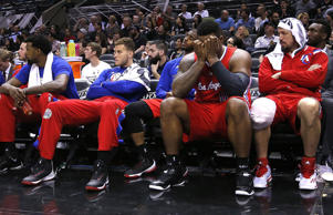 The Los Angeles Clipper bench watches during the final minutes of their loss to the San Antonio Spurs in Game Three of their NBA Playoffs matchup on April 24, 2015, in San Antonio.