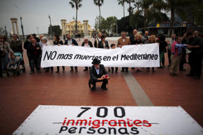 "People hold a banner that reads, ""No more deaths in the Mediterranean"" during a protest against the current immigration policy of the European Union, called by the ""Platform for solidarity with the immigrants of Malaga"", in Malaga, southern Spain, April 24, 2015."