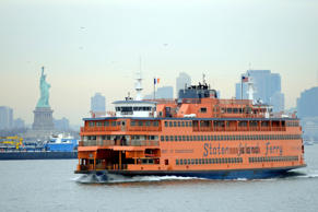 The Staten Island Ferry passes the Statue of Liberty as it makes its ways south from Manhattan to Staten Island on January 15, 2010 in New York.