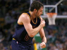 Kevin Love of the Cleveland Cavaliers leaves the court after suffering a dislocated shoulder against the Boston Celtics during game four of their playoff series April 26 in Boston.