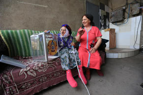 An elderly Kazakh woman, centre, casts her ballot into a ballot box, as she votes in her family house, outside Almaty, Kazakhstan, Sunday, April 26, 2015. Voters in Kazakhstan turned out in abundance at polling stations Sunday for a presidential election guaranteed to overwhelmingly reconfirm the 74-year-old incumbent, who has ruled over the former Soviet republic for more than 25 years.
