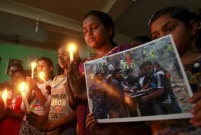 Students of a dance school hold candles during a prayer ceremony in Agartala, India, April 26, 2015, for victims of Saturday's earthquake in Nepal. Rescuers dug with their bare hands and bodies piled up in Nepal on Sunday after the earthquake devastated the heavily crowded Kathmandu Valley.