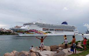 The cruise ship Norwegian Sky is shown in South Pointe Park as it heads to sea in Miami Beach, Fla.