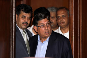 India's cricket chief Narainswamy Srinivasan, center, arrives to address a press conference in Kolkata, India, Sunday, May 26, 2013.
