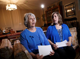 Elaine Weinstein, left, wife of American aid worker Warren Weinstein who was kidnapped in Pakistan, is joined by her daughter Jennifer Coakley, right, during an interview with The Associated Press on Aug. 8, 2014, at the family home in Rockville, Md.