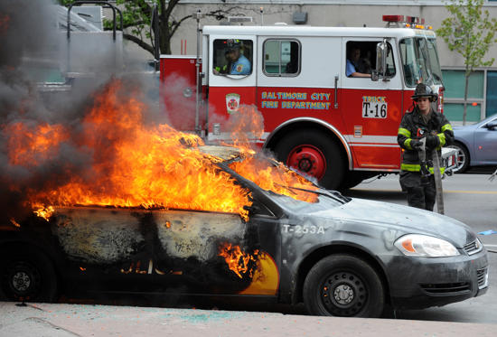 A Maryland Transit Authority patrol car burns at North and Pennsylvania Avenues on Monday, April 27, 2015, in Baltimore.