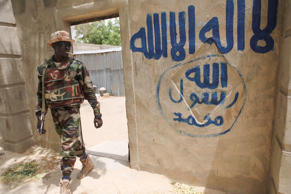 A Nigerien soldier walks out of a house that residents say a Boko Haram militant had forcefully seized and occupied in Damasak March 24, 2015. Boko Haram militants have kidnapped more than 400 women and children from the northern Nigerian town of Damasak that was freed this month by troops from Niger and Chad, residents said on Tuesday. Nigerian, Chadian and Niger forces have driven militants out of a string of towns in simultaneous offensives over the past month.