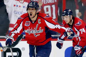 Alex Ovechkin (8) of the Washington Capitals celebrates a second period goal by teammate Joel Ward against the New York Islanders in Game Seven of their Stanley Cup playoffs matchup on April 27, 2015, in Washington, DC. The Capitals won 2-1 to win the series and advance.
