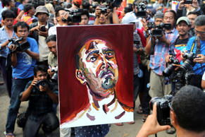 A team lawyer for two Australians Myuran Sukumaran and Andrew Chan carries a self-portrait drawn by Sukumaran after visiting the prison island of Nusakambangan at Wijayapura port in Cilacap, Central Java, Indonesia, April. 27, 2015.