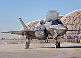REFILE - REMOVING TAXIS Third Marine Aircraft Wing's first F-35B arrives on the Marine Corps Air Station Yuma flightline, in Yuma, Arizona, in this U.S. Marine Corps handout photo taken November 16, 2012. The arrival highlights the official re-designation of Marine All Weather Fighter Attack Squadron 121, an F/A-18 Hornet Squadron, as the world's first operational F-35 squadron at MCAS Yuma, which took place November 20, 2012. Known as the F-35 Lightning II, the F-35B will eventually replace the Corps' aging legacy tactical fleet of AV-8B Harriers, F/A-18 Hornets and EA-6B Prowlers. REUTERS/U.S. Marine Corps/DVIDS/Lance Cpl. William Waterstreet/Handout (UNITED STATES - Tags: SCIENCE TECHNOLOGY TRANSPORT MILITARY) FOR EDITORIAL USE ONLY. NOT FOR SALE FOR MARKETING OR ADVERTISING CAMPAIGNS