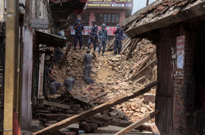 File: Rescue team members search for bodies in the debris of a collapsed temple at Basantapur Durbar Square on April 27, 2015 in Kathmandu, Nepal. A major 7.8 earthquake hit Kathmandu mid-day on Saturday, and was followed by multiple aftershocks that triggered avalanches on Mt. Everest that buried mountain climbers in their base camps. Many houses, buildings and temples in the capital were destroyed during the earthquake, leaving over 3000 dead and many more trapped under the debris as emergency rescue workers attempt to clear debris and find survivors.