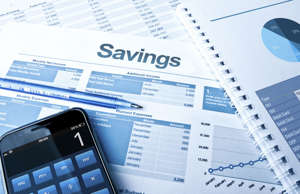 Savings plan with calculator and pie charts