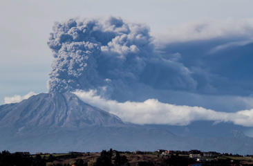 A thick plume pours from the Calbuco volcano, near Puerto Varas, Chile, Thursday, April 30, 2015. The volcano erupted again on Thursday, sending dark burst of ash and hot rock billowing into the air and prompting Chilean officials to order new evacuation of nearby residents. The eruptions at the Calbuco are the first in more than four decades. About 4,500 people have been evacuated since the Calbuco roared back to life on April 22, sending ash about 11 miles into the sky.
