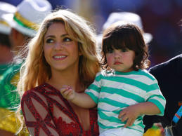 Singer Shakira holds her son Milan Pique during the 2014 World Cup closing ceremony at the Maracana stadium in Rio de Janeiro July 13, 2014.