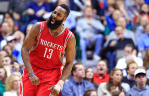 Feb 20, 2015; Dallas, TX, USA; Houston Rockets guard James Harden reacts against the Dallas Mavericks at American Airlines Center.