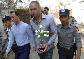 File picture: Philip Blackwood, second right, New Zealand general manager of V Gastro Bar, walks with Myanmar nationals, Bar owner Tun Thurein, second left, and its manager Htut Ko Ko Lwin, seen behind Blackwood