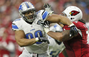 Detroit Lions defensive tackle Ndamukong Suh (90) battles Arizona Cardinals guard Paul Fanaika (74) during the first half of an NFL football game, Sunday, Nov. 16, 2014, in Glendale, Ariz.