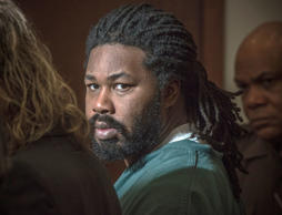 In this Nov. 14, 2014 file photo, Jesse Matthew Jr., right, looks toward the gallery while appearing in court in Fairfax, Va.