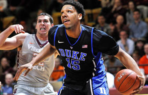 Duke Blue Devils center Jahlil Okafor (15) drives to the basket past Virginia Tech Hokies forward Christian Beyer (left) during a game on Feb. 25, 2015, at Cassell Coliseum in Blacksburg, Va.