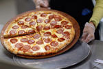 Terry Cheung prepares a pizza pie to be served at Everglades High School in Miramar, Florida.  Joe Raedle/Getty Images