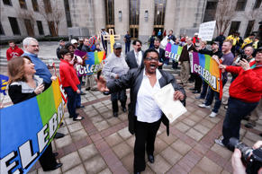 Now legally married, Dinah McCaryer, center, and Olanda Smith, behind McCaryer wearing a hat, are cheered by supporters of gay marriage as they leave the Jefferson County courthouse, Monday, Feb. 9, 2015, in Birmingham, Ala. Alabama began issuing marriage licenses to same-sex couples Monday after the U.S. Supreme Court refused to stop the marriages from beginning in the conservative southern state.