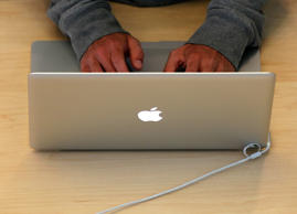 A customer uses the internet on a MacBook laptop at an Apple Store in San Francisco, California.