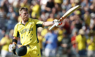 Australia's David Warner celebrates after scoring a century during their Cricket World Cup Pool A match against Afghanistan in Perth, Australia, Wednesday, March 4, 2015.