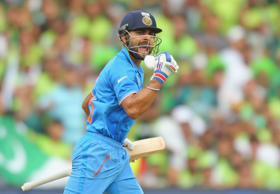Virat Kohli of India celebrates as he reaches his century during the 2015 ICC Cricket World Cup match between India and Pakistan at Adelaide Oval on February 15, 2015 in Adelaide, Australia.