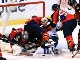 Florida Panthers goalie Al Montoya (35) goes for the puck as Toronto Maple Leafs center Leo Komarov is checked by right wing Jaromir Jagr (68) and defenseman Aaron Ekblad in the second period at BB&T Center.